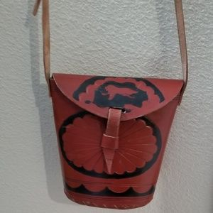 Vintage tooled leather small bag with long strap